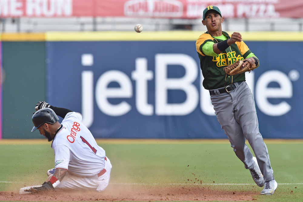 Cuban shortstop Dainer Moreira forces out Dominican Republic outfielder Leury Garcia in a Caribbean Series game on Feb. 3.