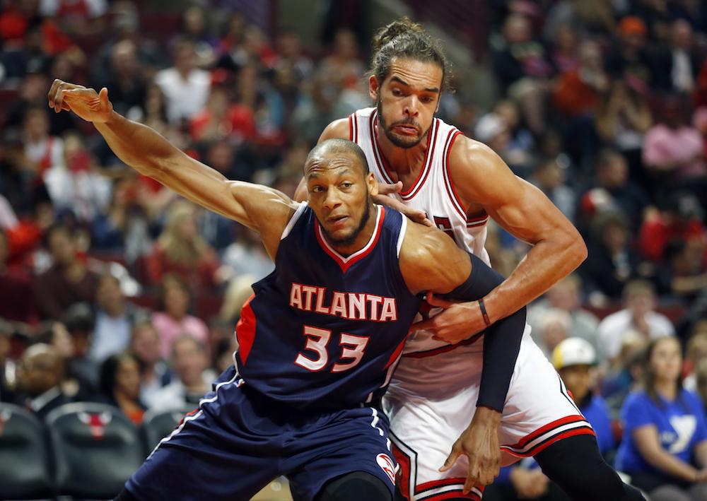 Adreian Payne (33) blocks out Chicago Bulls center Joakim Noah during a preseason game on Oct. 16, 2014.