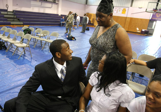 John Wall and his mother Frances Pulley (top right) seen back in 2009.
