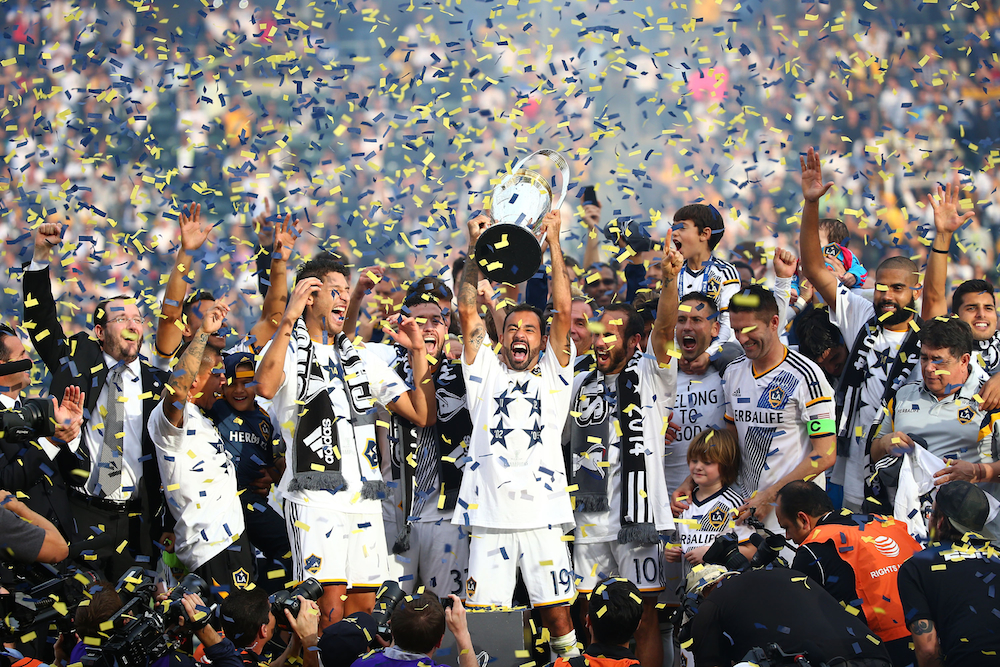 The LA Galaxy celebrate after winning the 2014 MLS Cup.