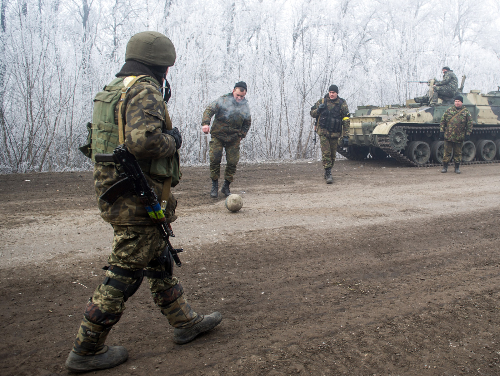 Ukrainian President Petro Poroshenko ordered troops to abide by the truce from midnight, in line with a deal reached in Minsk earlier this week with the leaders of Russia, Germany and France.