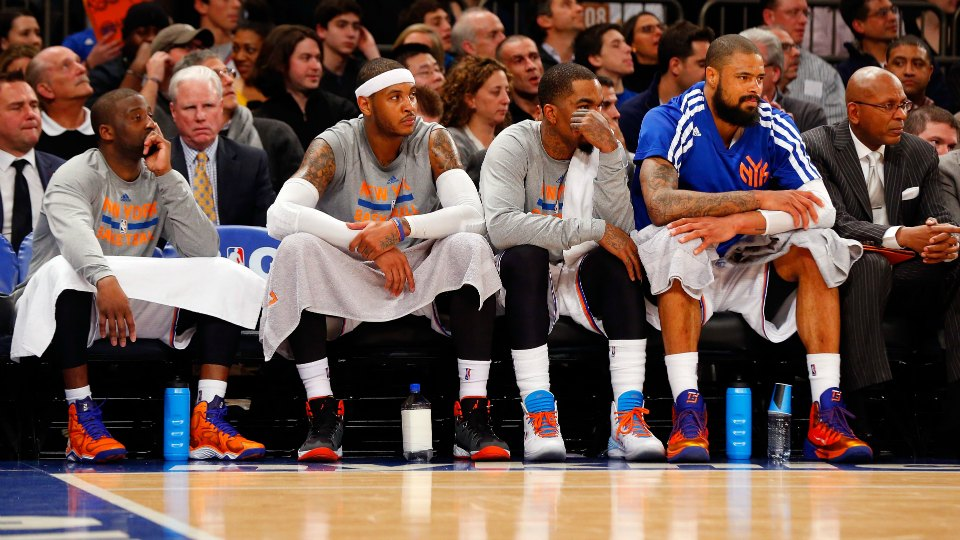 New York Knicks player (L-R) Ace Boogie, Nucky Thompson, Patrick Oakley, and Tommy Bunz rest on the bench