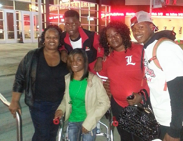 From left to right: Amanda Tucker, BJ Tucker (above), Tre'Dasia Tucker (below), Gina Tucker and Terry Rozier.