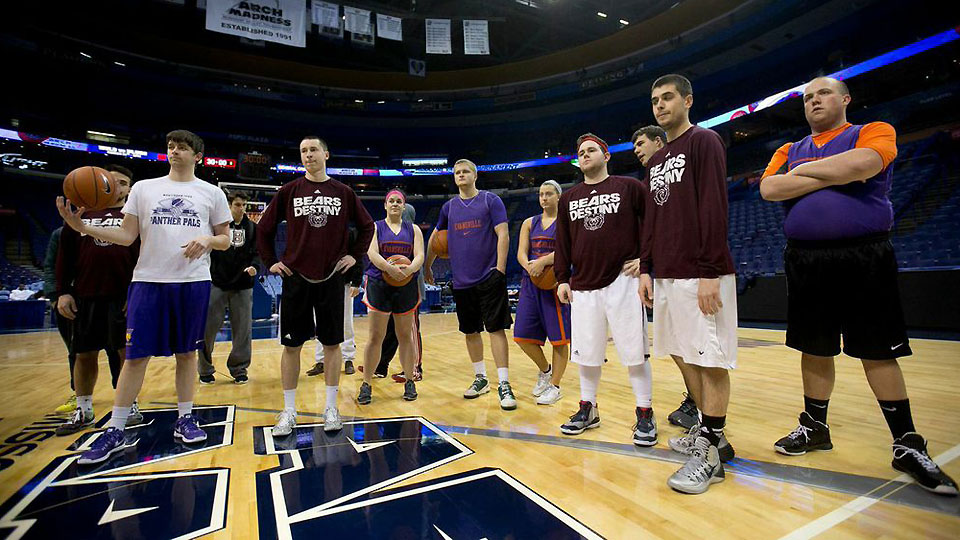"""Managers from Missouri State and Evansville prepare for their first-round games in the Missouri Valley Conference's """"Manager Madness"""" tournament."""