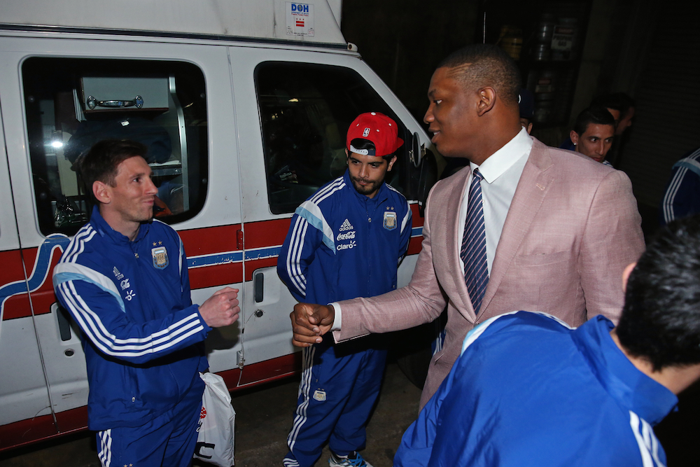 Washington Wizards center Kevin Seraphin meets Argentina's Lionel Messi.
