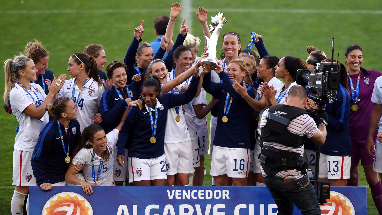 The U.S. women's national team celebrates winning the Algarve Cup after a 2-0 triumph over France. Julie Johnston and Christen Press scored, and Hope Solo saved a penalty kick.