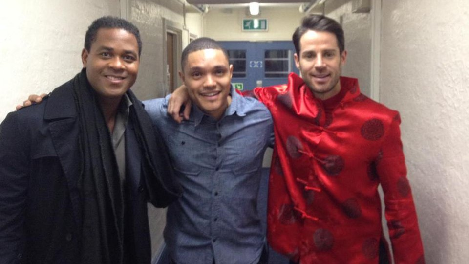 Trevor Noah (center) with retired soccer stars Patrick Kluivert (left) and Jamie Redknapp (right)