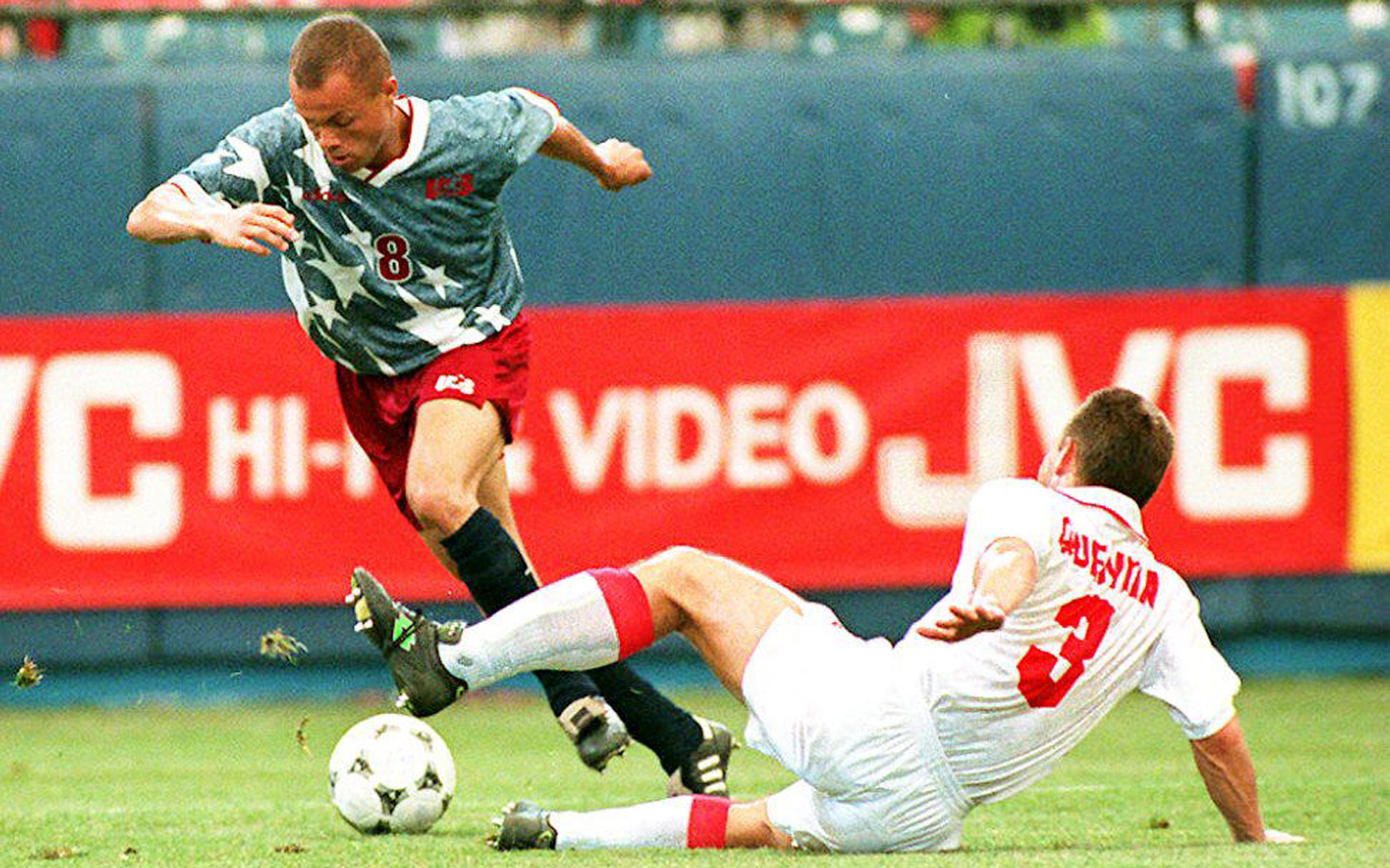 Earnie Stewart maneuvers by Yvan Quentin in the USA's 1-1 1994 World Cup draw vs. Switzerland.
