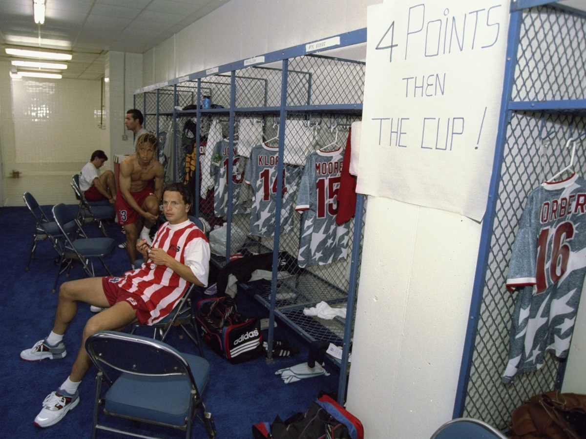 Frank Klopas sits at his locker room prior to the USA's 1994 World Cup match against Switzerland. On the wall, the message is clear.