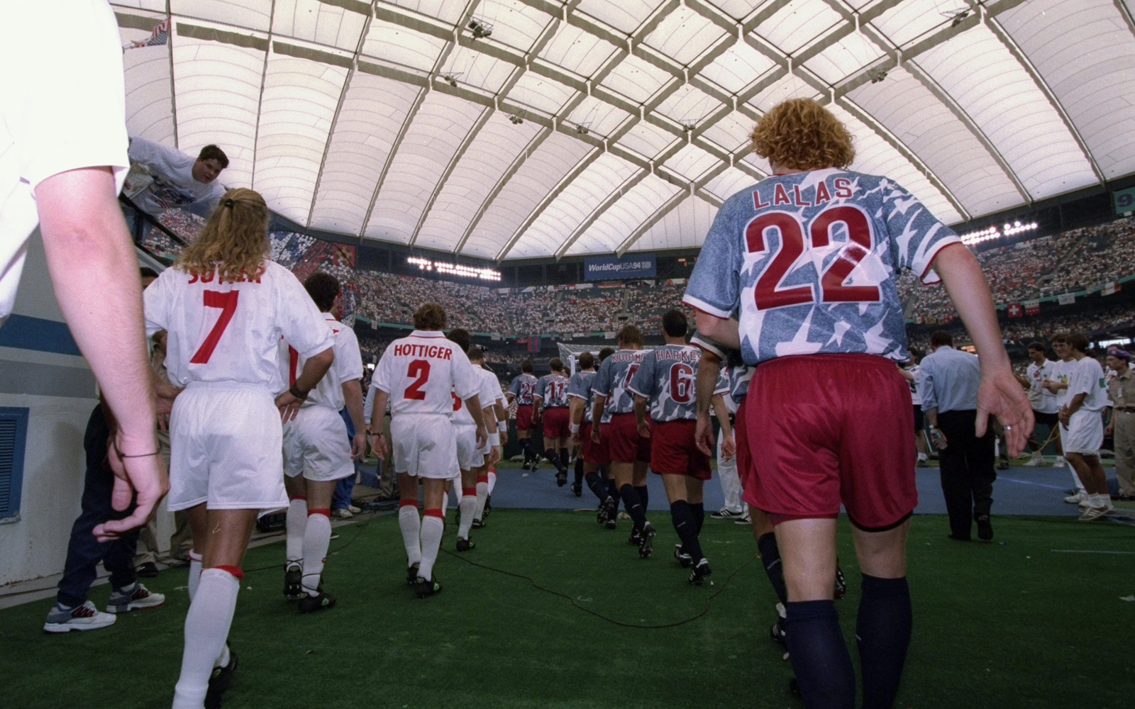 Alexi Lalas walks out of the tunnel and onto the Silverdome field