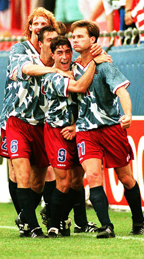 Eric Wynalda (right) is mobbed after scoring off a stellar free kick, which tied the game at the time and ultimately led to the USA's first World Cup point in 44 years.