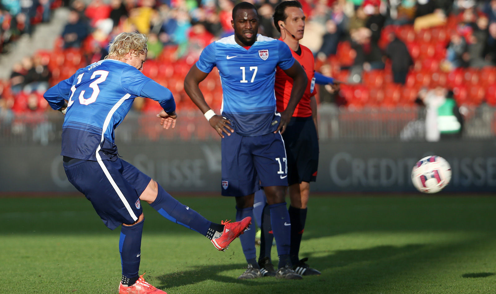 Jozy Altidore watches as Brek Shea hits a perfect free kick to put the USA on the board against Switzerland. The Americans settled for a 1-1 draw.