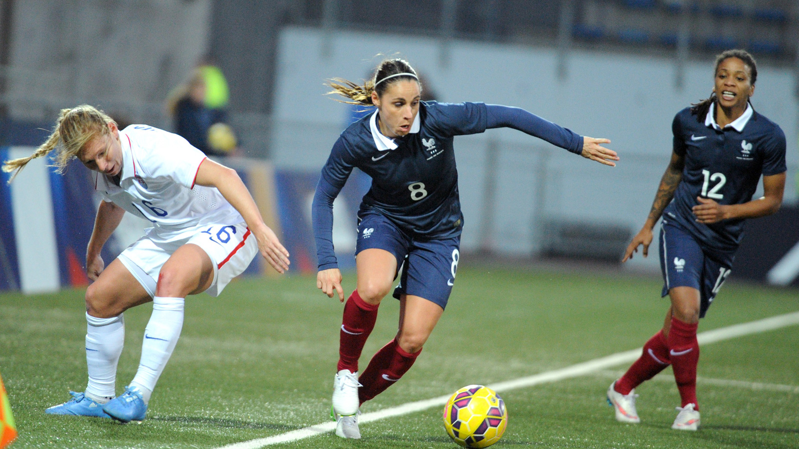 Lori Chalupny (left) and the USWNT had a tough time keeping pace with Jessica Houara (center) and France in a 2-0 loss in a friendly in Lorient. The match was the first of two played without suspended goalkeeper Hope Solo.