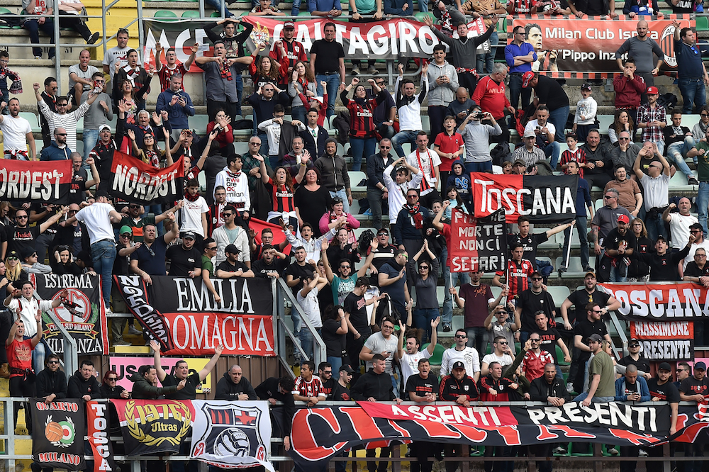 AC Milan fans show their support during a Serie A match against US Citta di Palermo at Stadio Renzo Barbera on April 4 in Palermo, Italy.