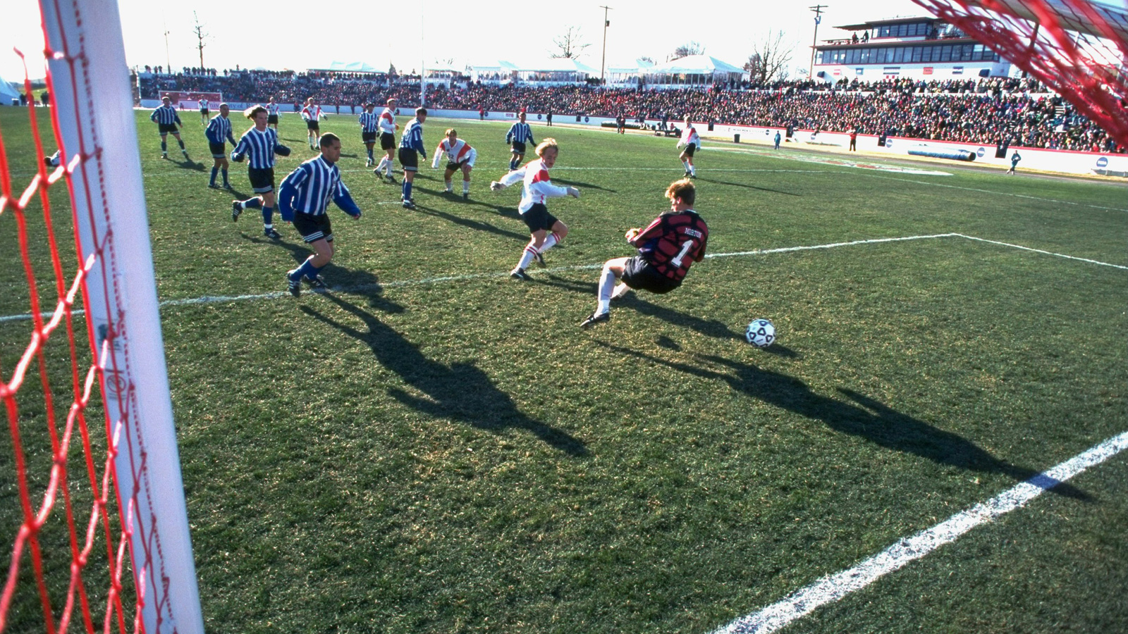 Lars Hansen scores one of Wisconsin's two goals in a 2-0 1995 men's soccer national championship triumph over Duke.