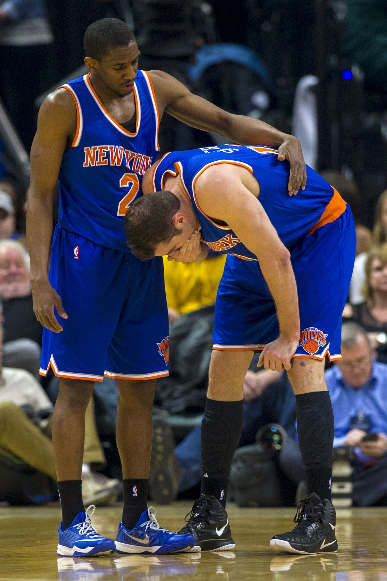 Jason Smith potentially fighting back vomit after watching an atrocious Knicks play.