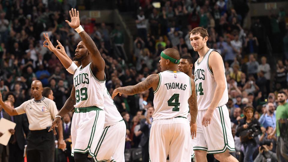 Jae Crowder (left) and the Celtics celebrate a victory over the Raptors.