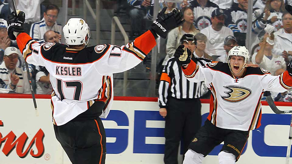 Jakob Silfverberg (above, right) celebrates after assisting Ryan Kesler (17) on his game-tying goal in the third period of the Ducks' win over the Jets on Monday.