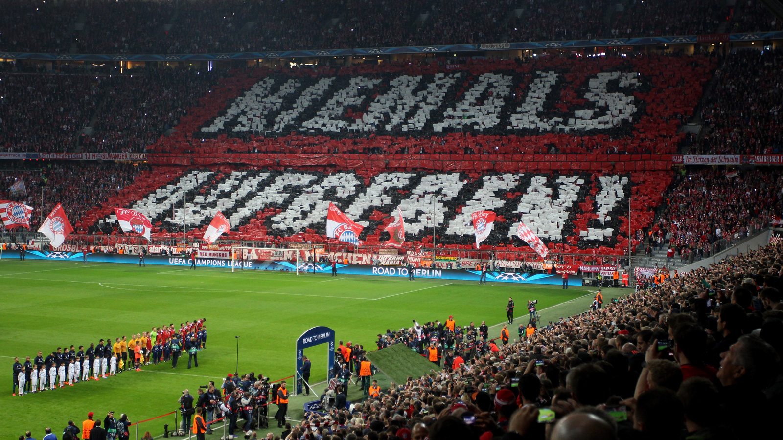 "Bayern Munich fans implore their club to (translated) ""Never give up"" in the Champions League quarterfinal second leg vs. Porto. Bayern then turned a 3-1 first-leg deficit into a 7-4 aggregate win and a place in the semifinals."