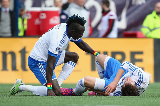 Dominic Oduro tends to Cameron Porter after the Montreal Impact rookie tears his ACL against the New England Revolution.