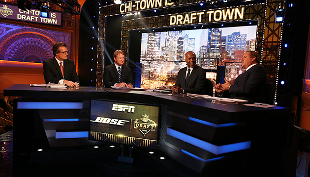 Mel Kiper Jr., Jon Gruden, Louis Riddick and Chris Berman on ESPN's NFL draft set in Chicago.