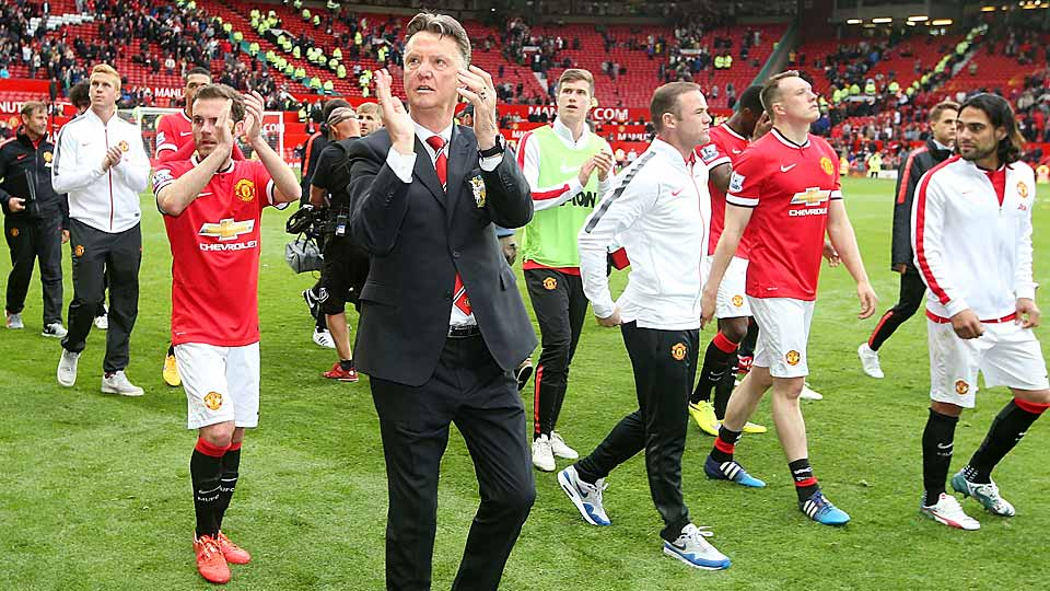 Manchester United manager Louis van Gaal (center) celebrates with the home fans at Old Trafford