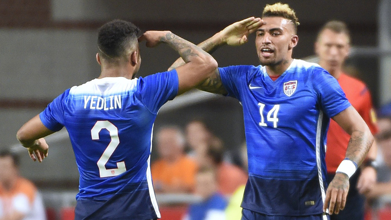 DeAndre Yedlin and Danny Williams salute each other after the latter's goal–his first international strike–brought the U.S. level with the Netherlands at 3-3 in the 89th minute.