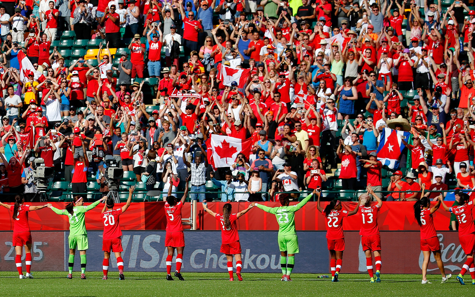 Canada players take a group bow in front of the home support.