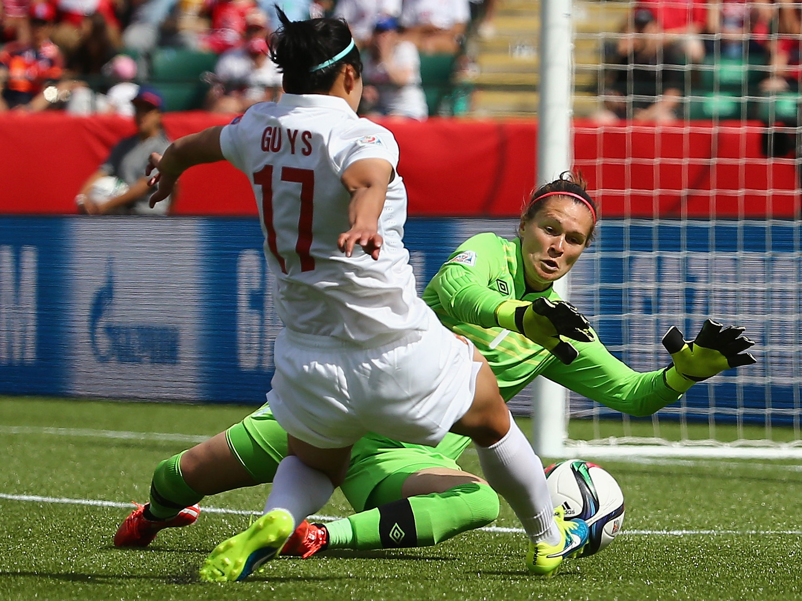 Canada goalkeeper Erin McLeod makes a first-half save on Gu Yasha to keep the upstart visitors off the board.