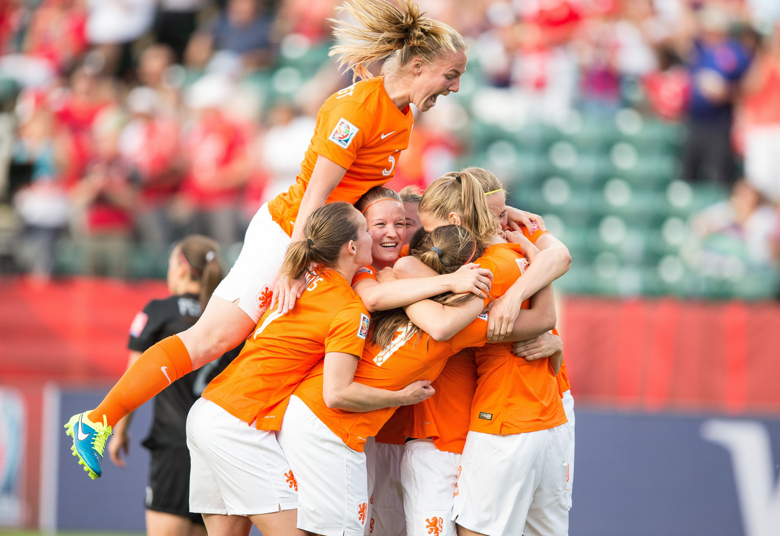 Netherlands players pile on Lieke Martens after her sensational goal.