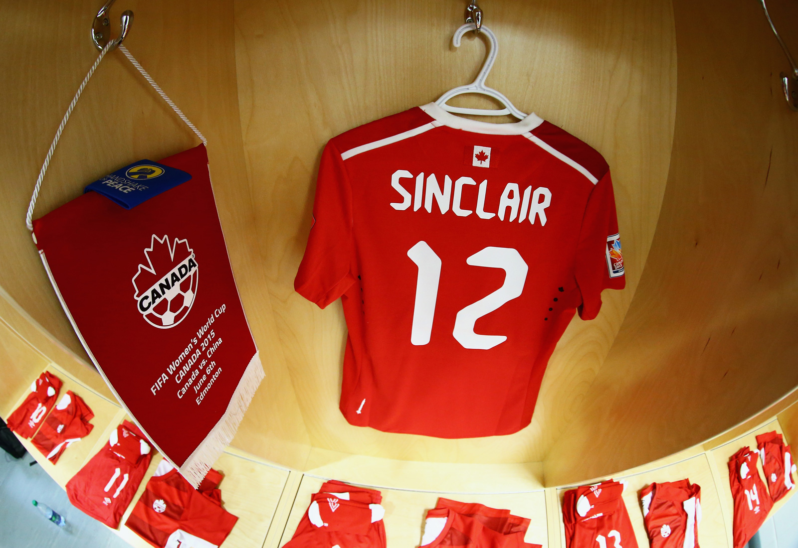 Canada captain Christine Sinclair's jersey and armband hang in her locker at Commonwealth Stadium.