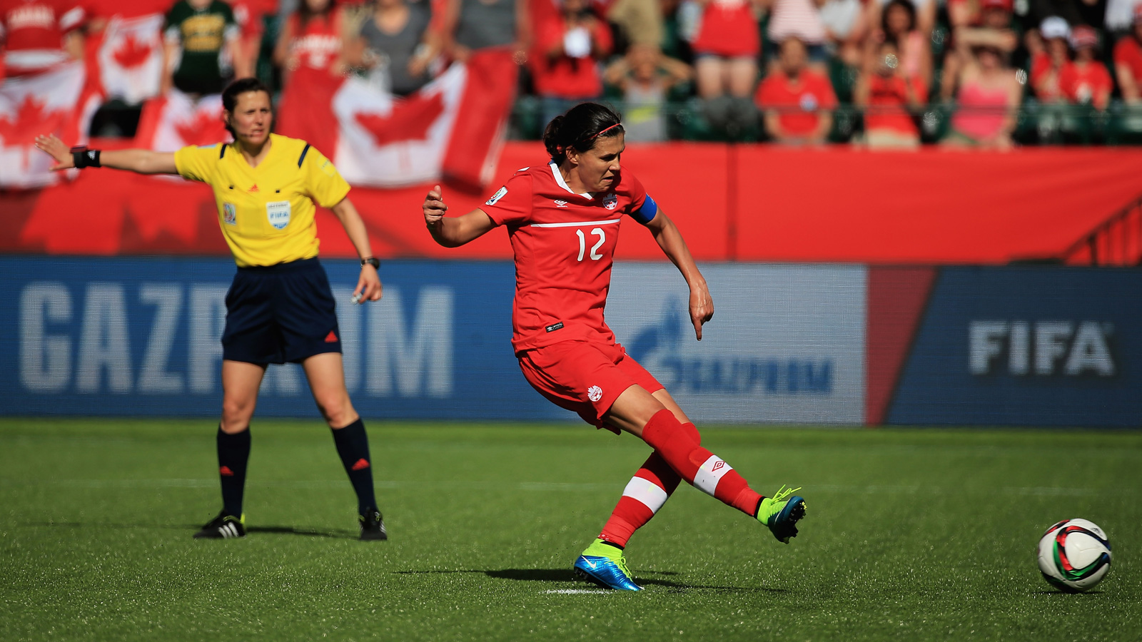Christine Sinclair takes the penalty kick in stoppage time, after Ukrainian referee Natalia Rachynska ruled that Adriana Leon was fouled by Rong Zhao.