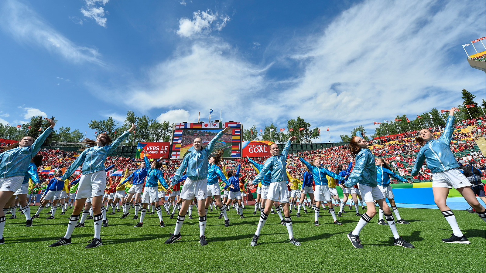 Children perform on the field at Commonwealth Stadium during the opening ceremony ahead of Canada's match vs. China.