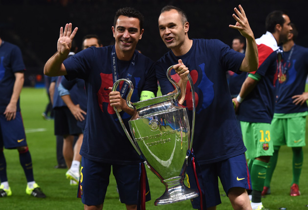 Going out a champion: Xavi, in his final match with Barcelona, celebrates his fourth Champions League title with teammate and longtime friend Andres Iniesta.
