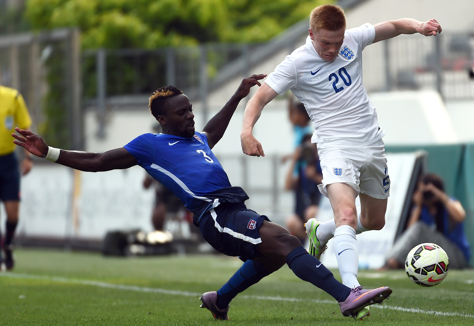 USA defender Boyd Okwuonu makes a tackle on England's Duncan Watmore in the Toulon Tournament third-place game. The U.S. U-23s won 2-1, sealing their best finish in the tournament.