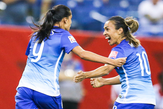 Brazil's Andressa Alves, Marta celebrate a Women's World Cup goal vs. Spain
