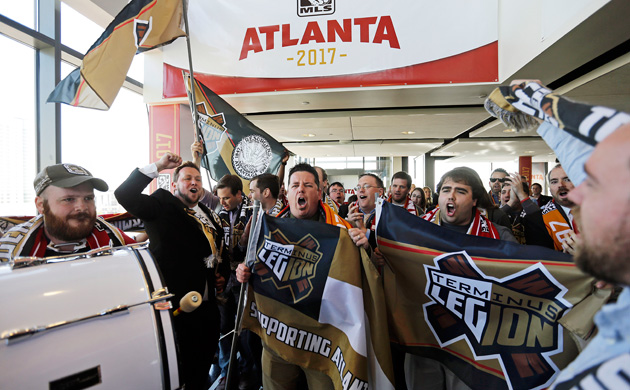 Fans of Atlanta's Terminus Legion celebrate the day Atlanta was granted an MLS expansion franchise