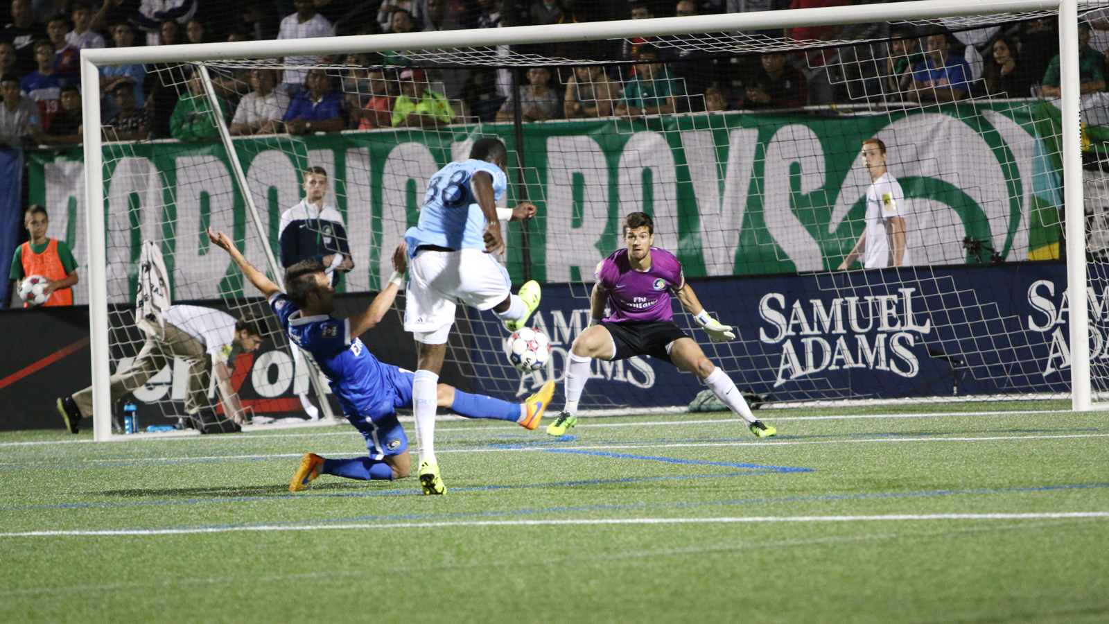 In the second half of their U.S. Open Cup fourth-round match, NYCFC midfielder Kwadwo Poku (88) fires a shot toward Cosmos goalkeeper Jimmy Maurer (1). Maurer was unable to save it, giving Poku his second goal of the game