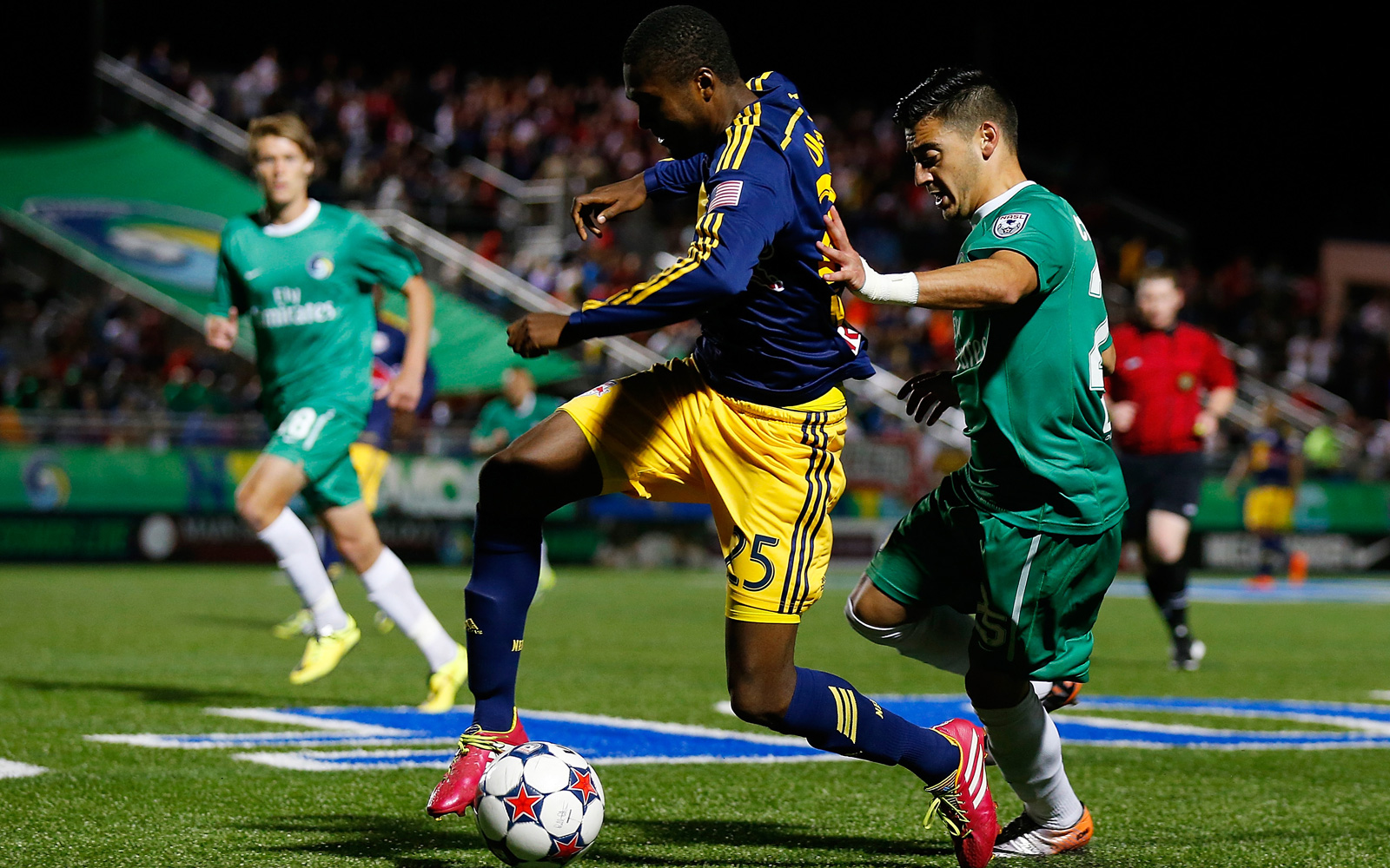 New York Red Bulls' Chris Duvall (25) takes on the Cosmos' Hagop Chirishian in their 2014 U.S. Open Cup clash.