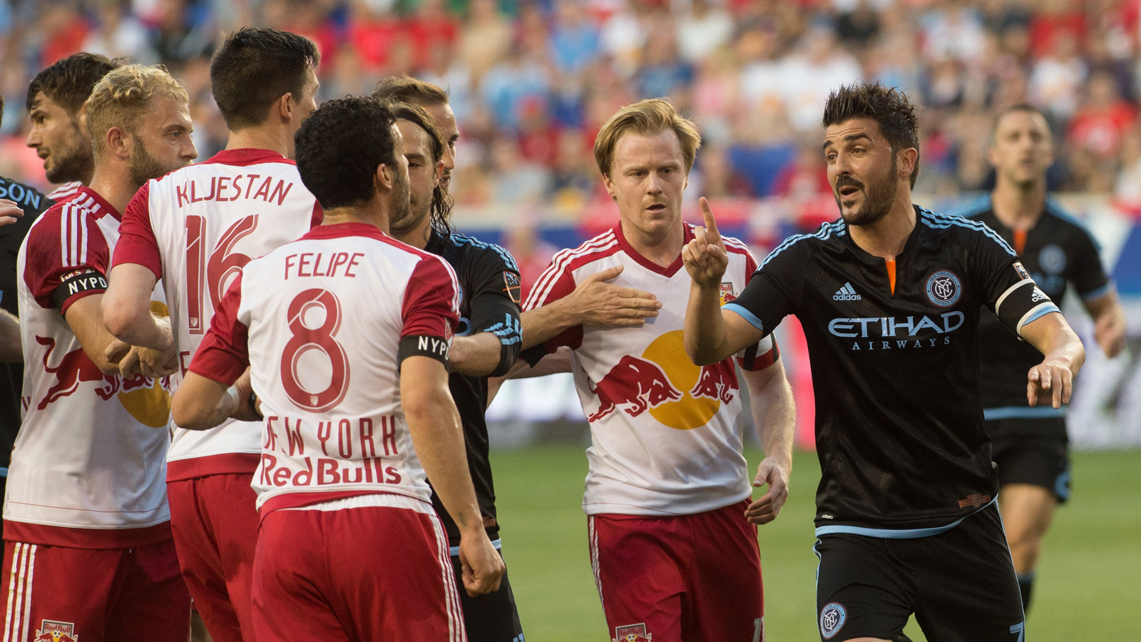 NYCFC captain David Villa, right, takes exception with Red Bulls midfielders Felipe, Dax McCarty and Sacha Kljestan in a heated moment in NYCFC's first match against the Red Bulls.