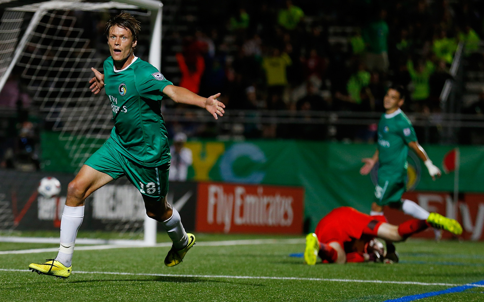Mads Stokkelien celebrates one of his two goals in the New York Cosmos' 3-0 win over the New York Red Bulls in the 2014 U.S. Open Cup.