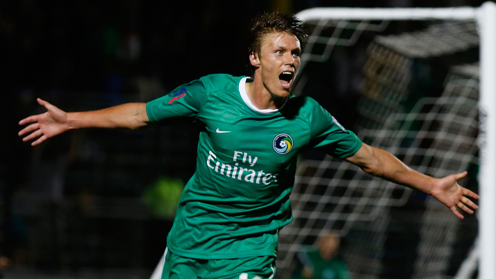 Mads Stokkelien scored twice in leading the New York Cosmos over the New York Red Bulls 3-0 in the 2014 U.S. Open Cup fourth round.