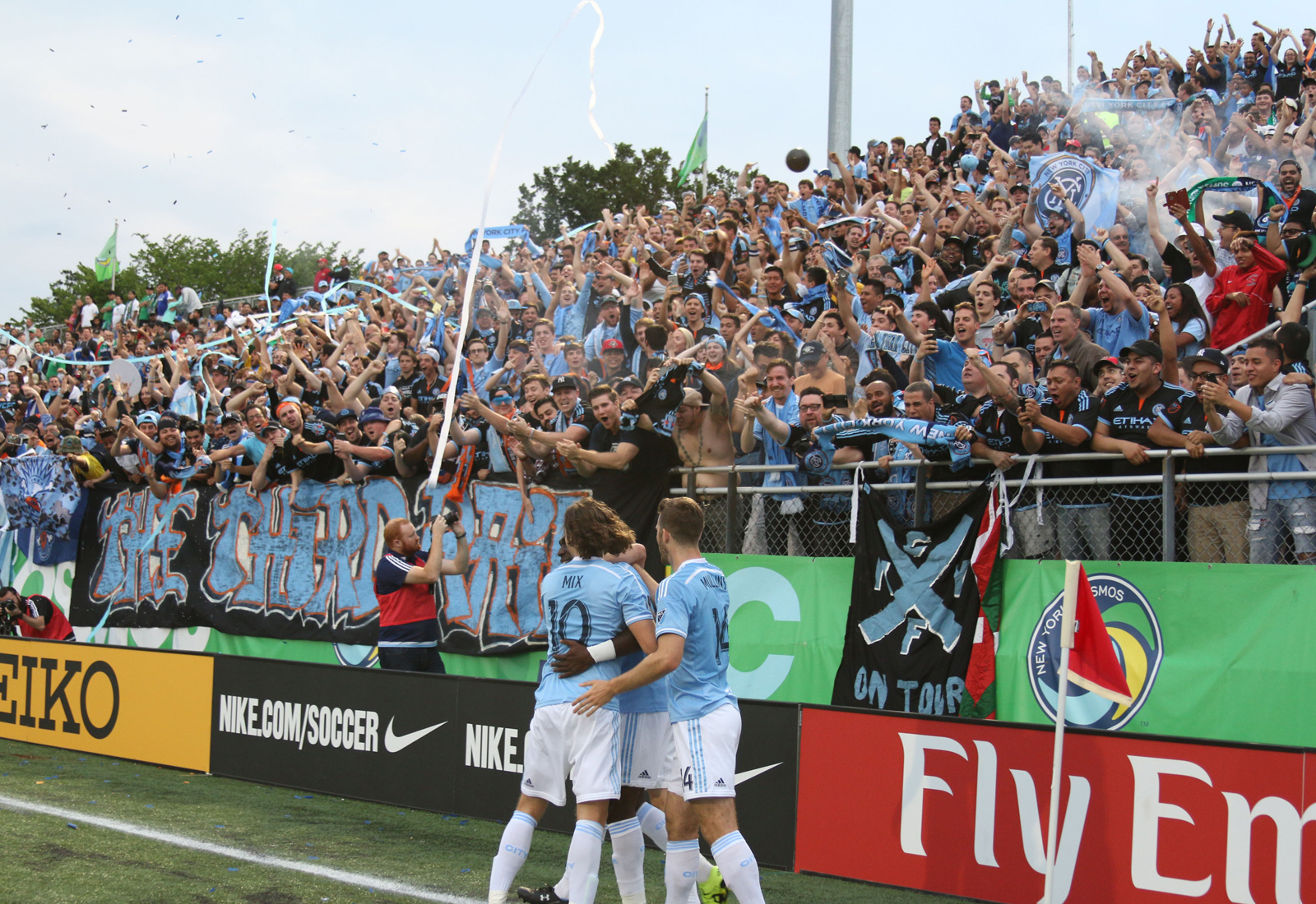 NYCFC midfielder Mix Diskerud (10) and the NYCFC supporters join forward Patrick Mullins (14) in celebrating Kwadwo Poku's (88) opening goal against the New York Cosmos.