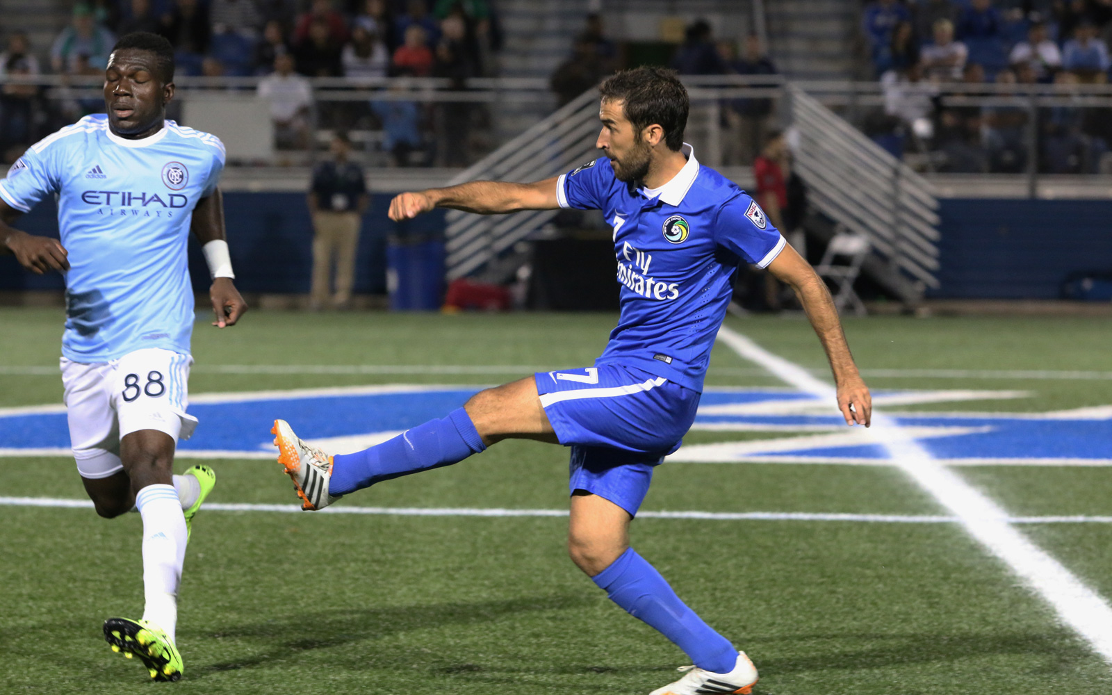 In the 57th minute of the U.S. Open Cup fourth round match, Cosmos star attacker Raul (7) moves the ball into the attacking third, slipping it past midfielder Kwadwo Poku (88), NYCFC's man of the match