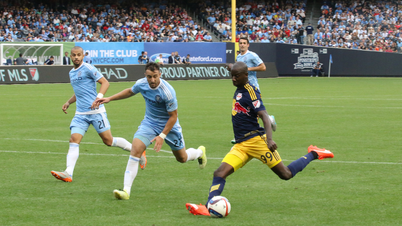 New York Red Bulls striker Bradley Wright-Phillips (99) beats NYCFC defender R.J. Allen (27) and puts a strike on goal during the second half of their June 28 match at Yankee Stadium.