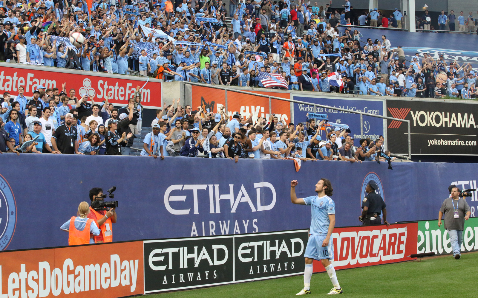 After a 3-1 loss to the New York Red Bulls, NYCFC midfielder Mix Diskerud (10) throws a ball into the home supporters section. The gesture earned Diskerud one final cheer from his fans despite the result.