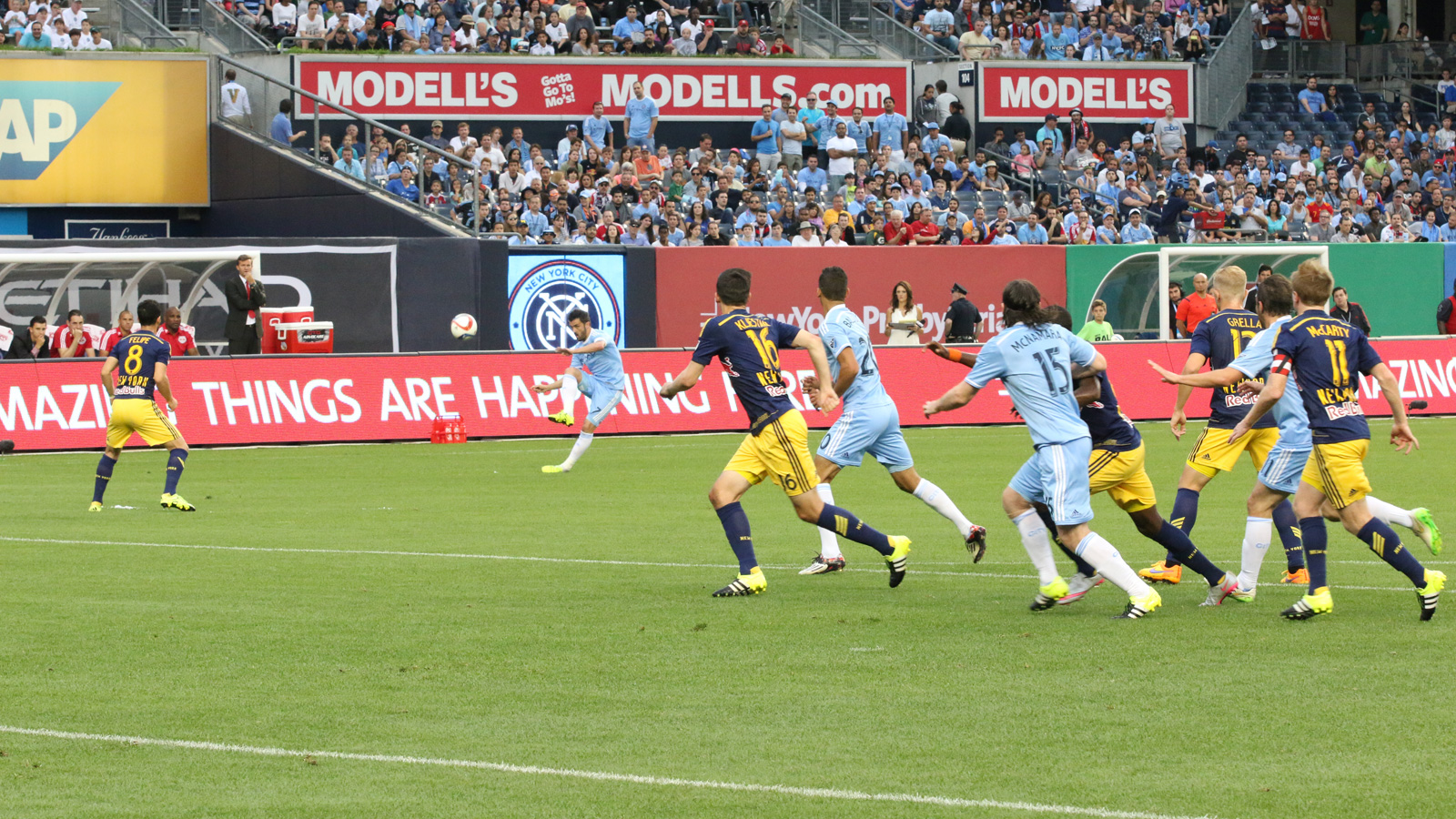NYCFC striker and captain David Villa sends a free kick into traffic near the New York Red Bulls' goal in the first half of their clash at Yankee Stadium on June 28.