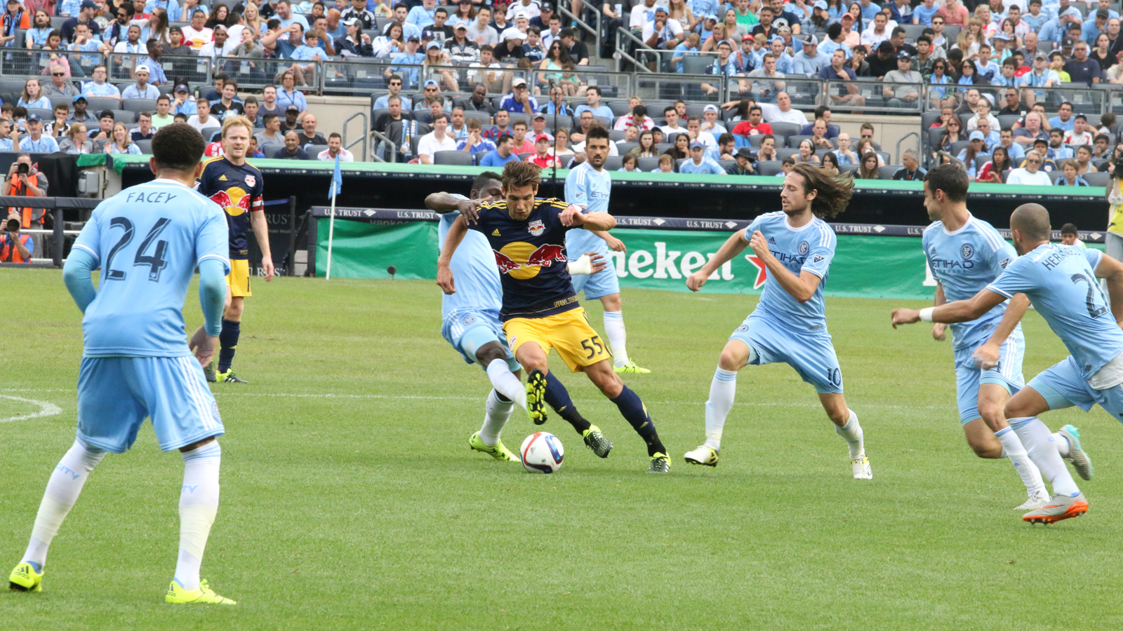 New York Red Bulls defender Damien Perrinelle (55) shakes off Kwadwo Poku (88) and Mix Diskerud (10) during the second half of the season's second Red Bulls-NYCFC clash.