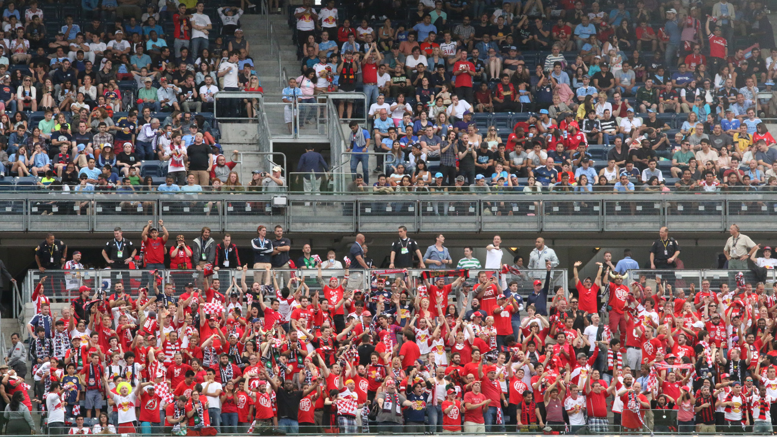 The traveling fans sitting in the New York Red Bulls' supporters section at Yankee Stadium react to the third and final Red Bulls goal of the match, scored by defender Matt Miazga (20) in the 73rd minute of a 3-1 road win over NYCFC.