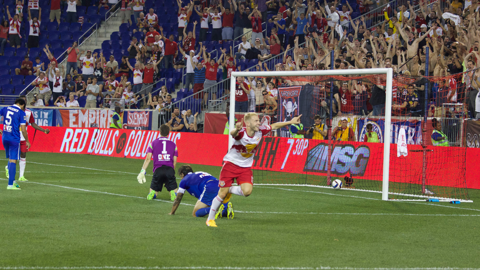 New York Red Bulls striker Mike Grella (13) celebrates his goal, the Red Bulls' seventh in a week against the two other New York teams. The 4-1 result against the Cosmos was preceded four days prior by a 3-1 victory over NYCFC.
